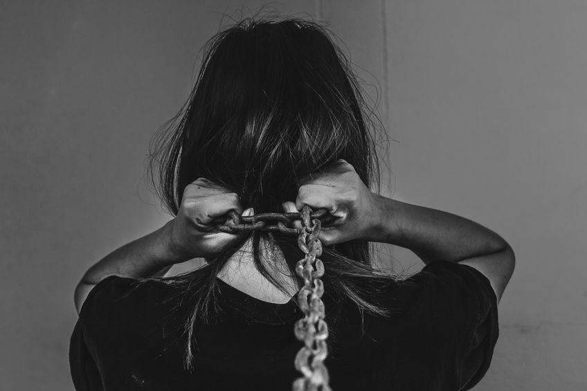 Children, women chained a black background.